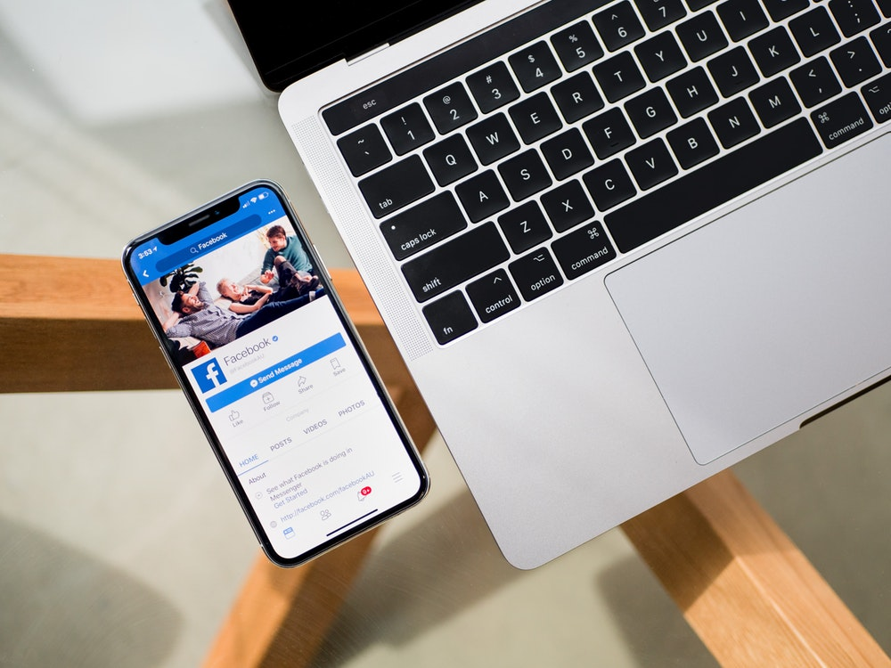 iPhone X beside MacBook